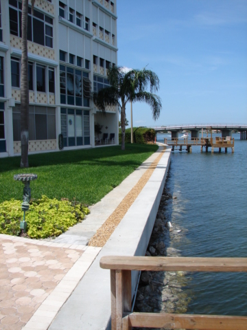 A new commercial concrete seawall cap on the water