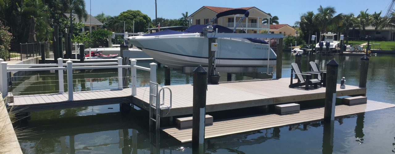 A composite stationary dock with an aluminum direct drive boat lift