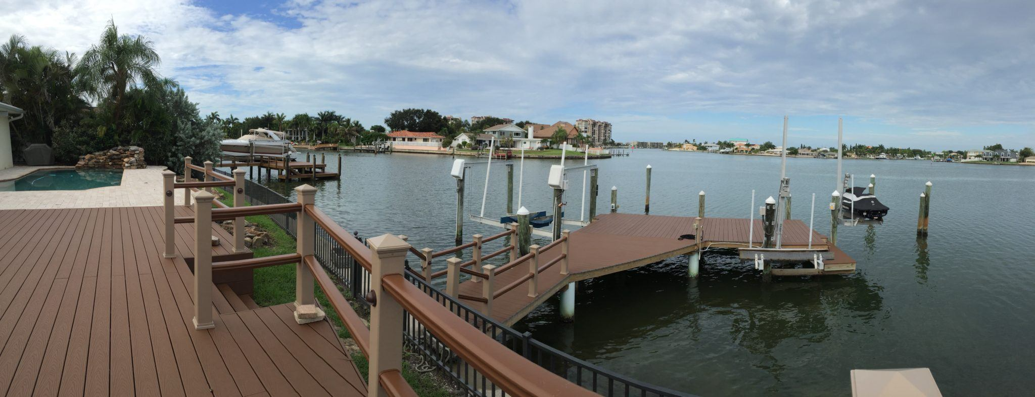 A matching Trex deck and dock with Trex composite handrail on the water