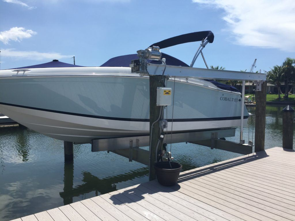 A new aluminum boat lift with direct drive assemblies on the water
