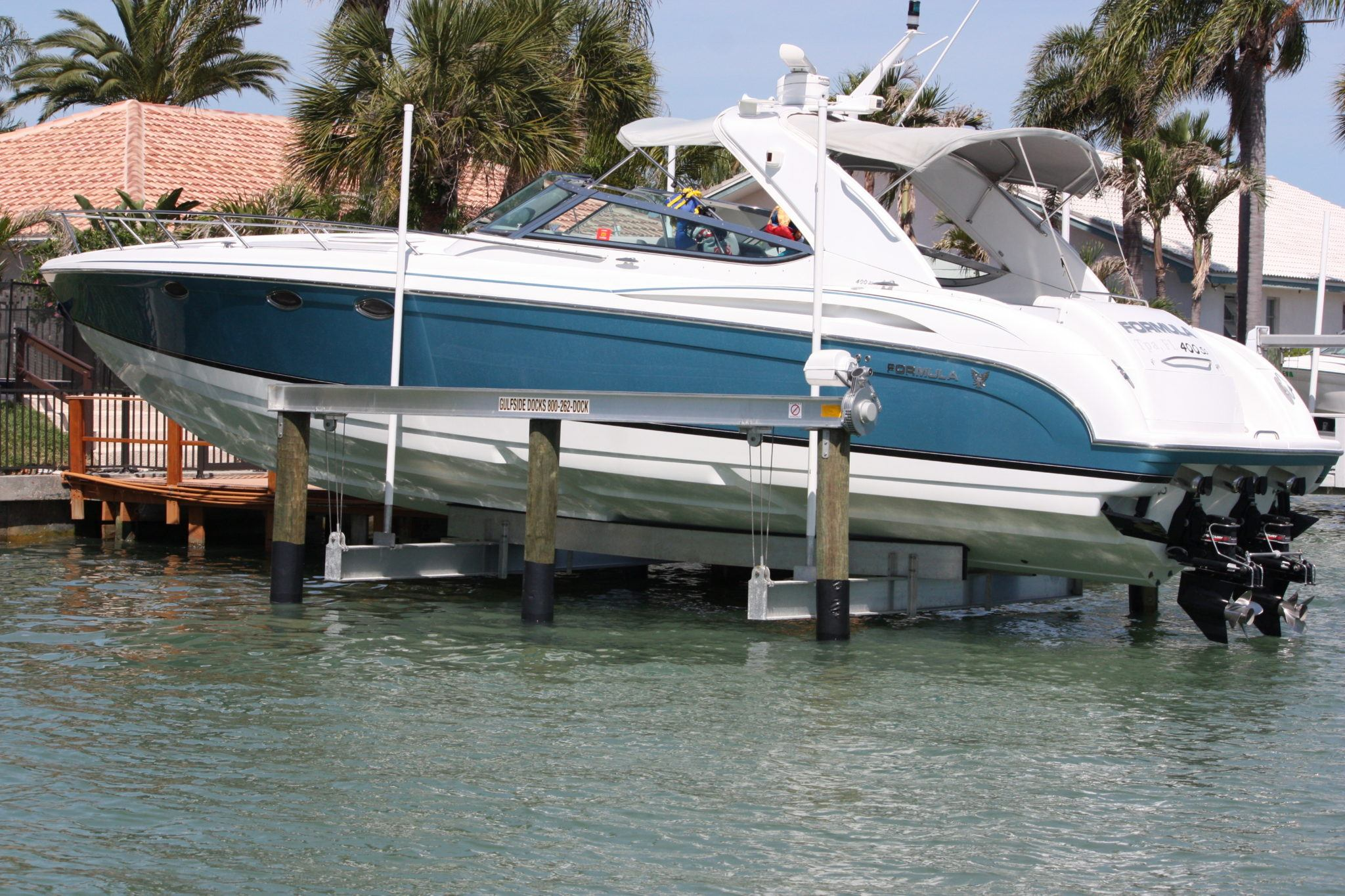 A low profile aluminum boat lift with a Sea-Drive assembly