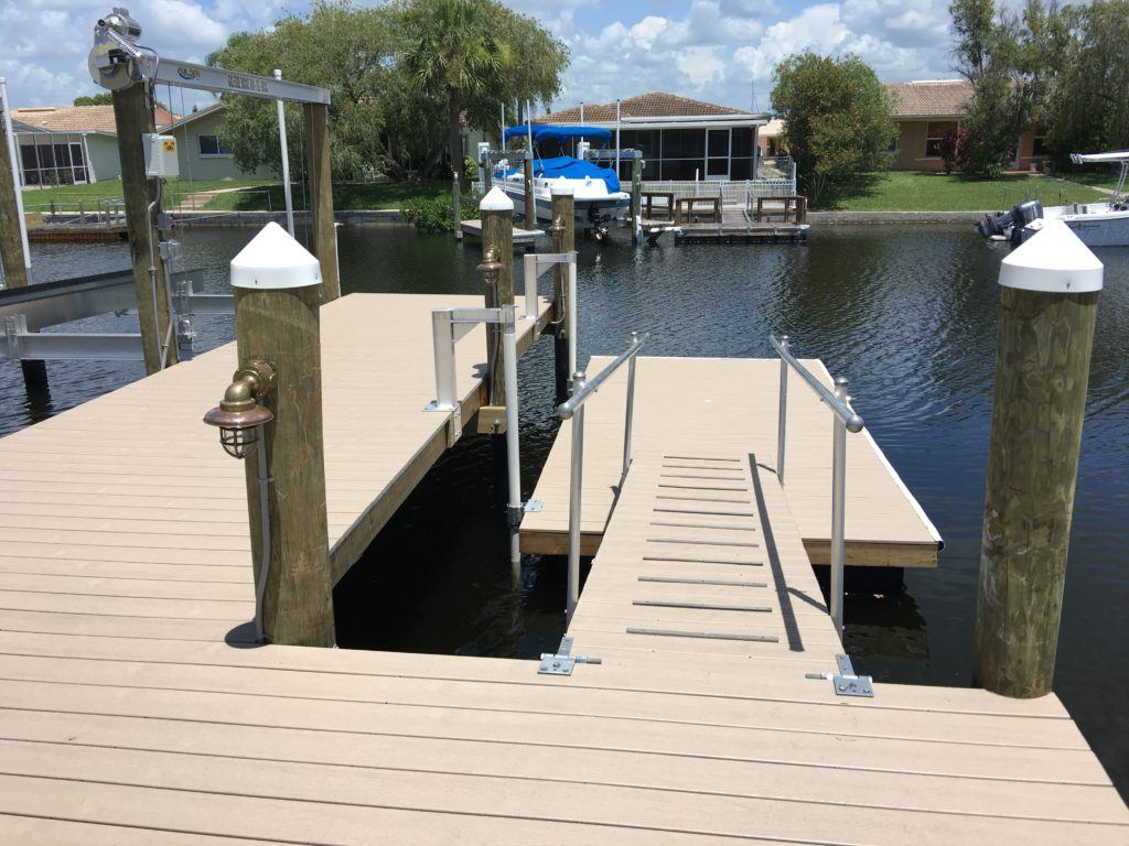 A new floating dock with Trex composite decking attached to a stationary dock