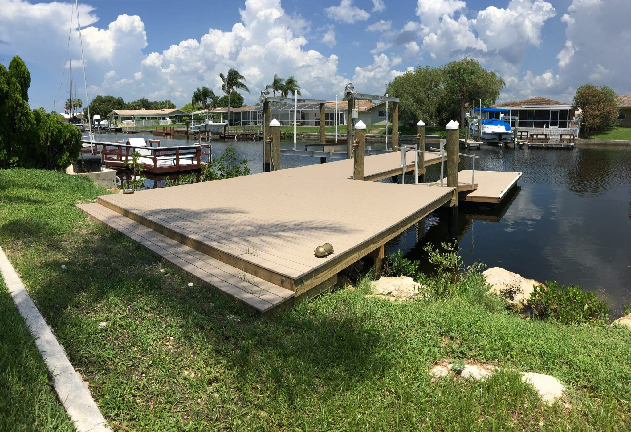 A new Trex stationary dock and attached floating dock with a new aluminum boat lift