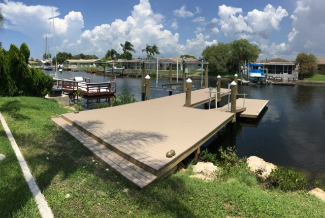 A new Trex stationary and floating dock with a new boat lift on the water