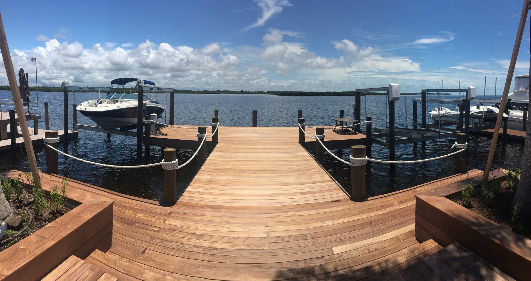 A new composite dock with two boat lifts on each side on the water