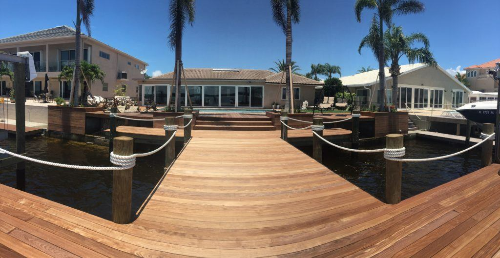 A new deck and dock built on the water with composite decking material