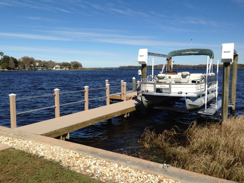 A new Trex dock with Trex composite hand rail with aluminum rails and a new boat lift