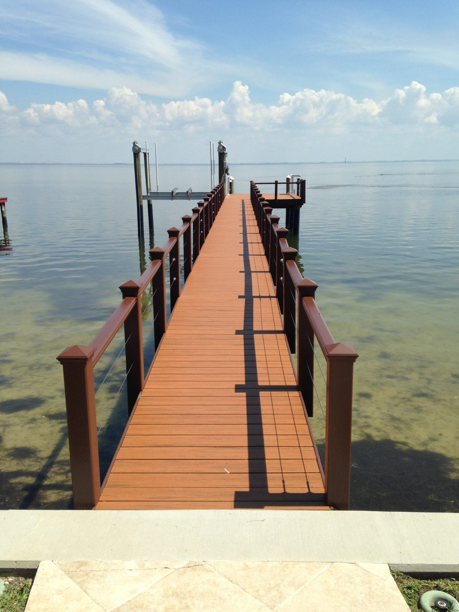 A Trex stationary dock with Trex composite handrail with cable railing