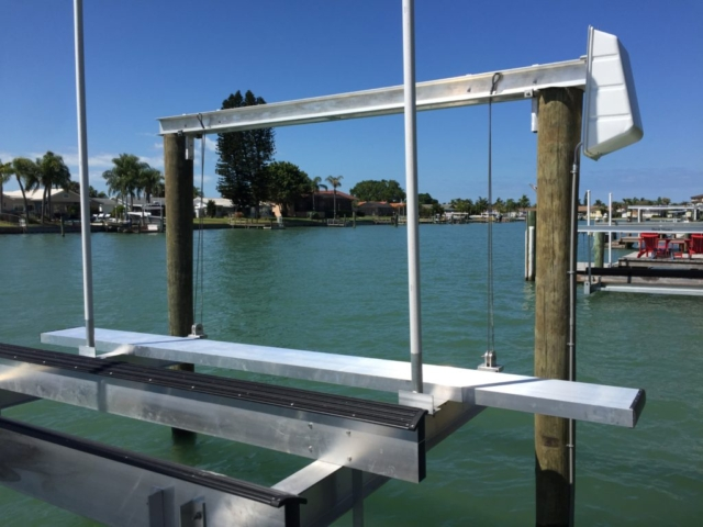 Aluminum walkboard on a new boat lift on the water