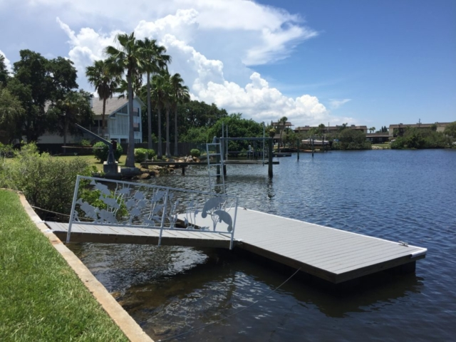 Composite decking platform floating dock over the water with a gangway ramp