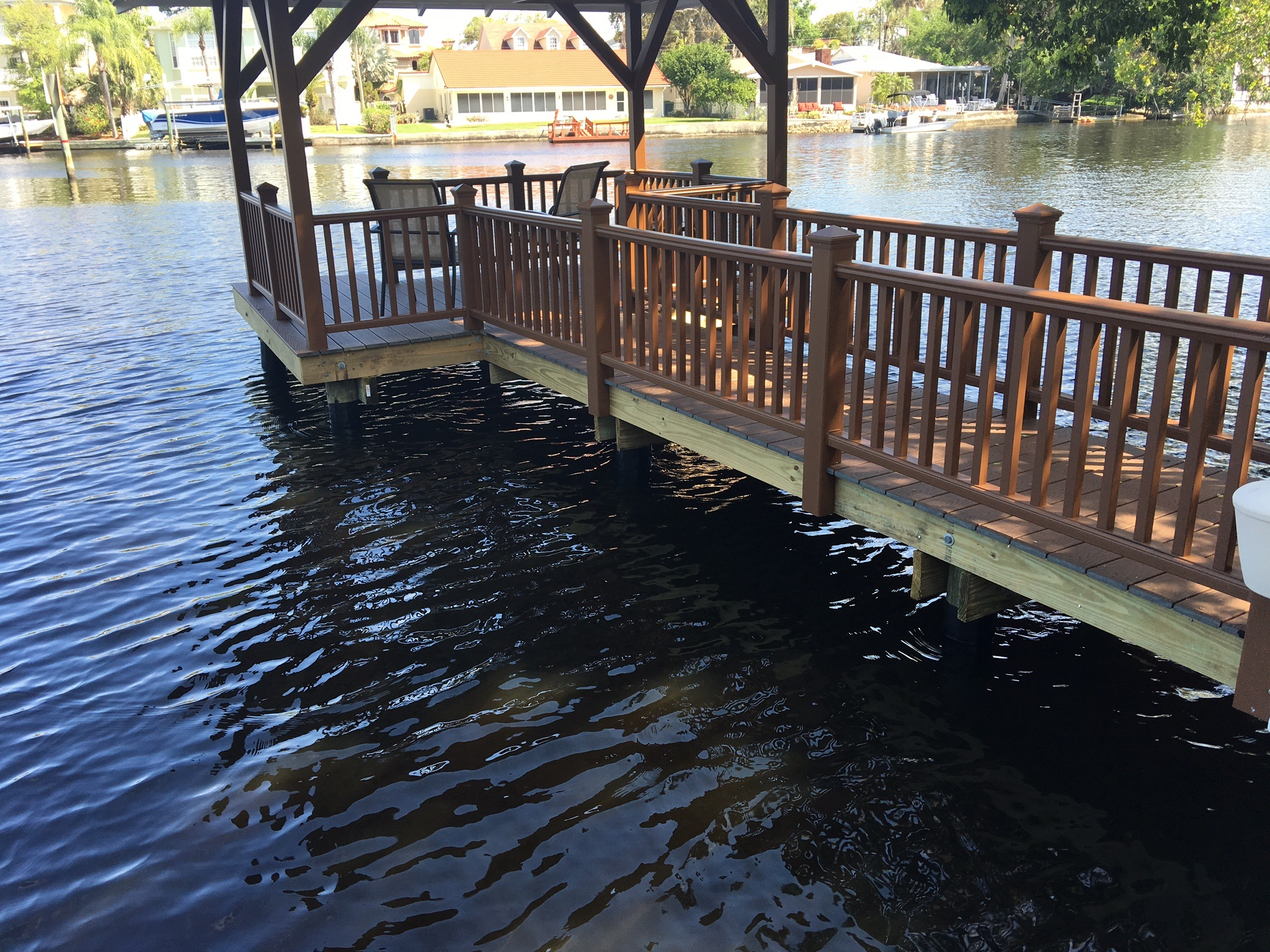 Composite Trex hand railing with balusters around a dock over the water